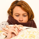 Woman checking feaver with digital termomether girl with flu Stock Photos