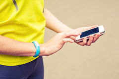 Woman checking fitness and health tracking wearable device.  royalty free stock photos