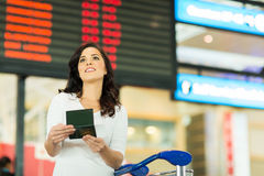 Woman checking flight information Royalty Free Stock Photos