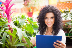 Woman checking flowers Stock Photos