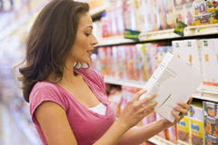 Woman checking food labelling Stock Photography