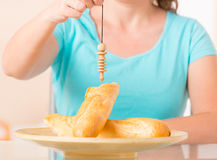 Woman checking food with pendulum stock photo