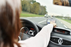Woman checking gps on the road royalty free stock image