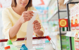 Woman checking the grocery receipt Stock Photography