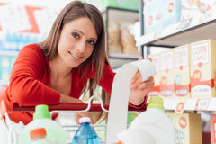 Woman checking the grocery receipt Royalty Free Stock Photo