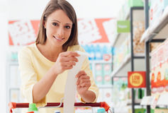 Woman checking the grocery receipt royalty free stock photography
