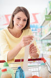 Woman checking the grocery receipt stock image