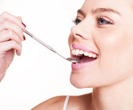 Woman checking her dental health Royalty Free Stock Images