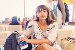 Woman checking her passport in an airport terminal Royalty Free Stock Photo