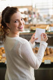 Woman checking her shopping list Stock Image
