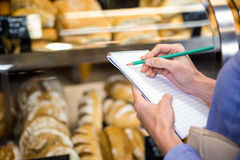 Woman checking her shopping list Stock Photo