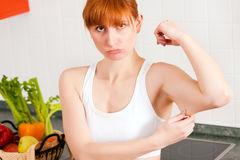 Woman is checking her triceps Stock Photo