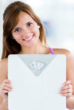 Woman checking her weight Royalty Free Stock Images