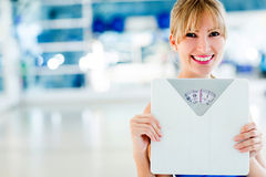 Woman checking her weight Royalty Free Stock Photo