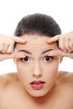 Woman checking her wrinkles on her forehead stock photo
