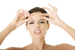 Woman checking her wrinkles on her forehead Stock Photography