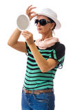 Woman checking herself in mirror aranging white hat Royalty Free Stock Photo