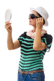 Woman checking herself in mirror Royalty Free Stock Images