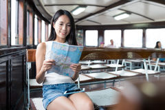 Woman checking location on city map in ferry at Hong Kong Stock Photos