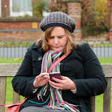 Woman checking mobile phone Stock Image