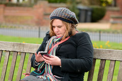 Woman checking mobile phone Royalty Free Stock Images