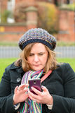Woman checking mobile phone Royalty Free Stock Photos