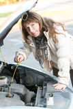 Woman checking oil level Royalty Free Stock Photography