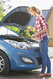 Woman Checking Oil Level In Car Engine Stock Images