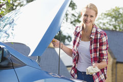Woman Checking Oil Level In Car Engine Royalty Free Stock Images