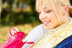 Woman checking out bag content Stock Image
