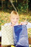 Woman checking out bag content Stock Images