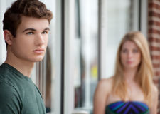 Woman Checking Out Handsome Young Man Stock Images