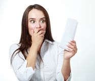 Woman checking over the receipt Stock Images