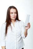 Woman checking over the receipt Stock Image
