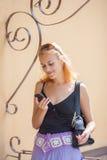 Woman checking phone Stock Photo