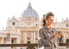 Woman checking photos in camera in vatican city Stock Images