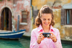 Woman checking photos in camera in venice, italy Royalty Free Stock Photography
