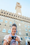 Woman checking photos in front of palazzo vecchio Stock Photography