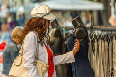 Woman checking price in Italian street market Stock Photo