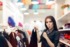 Woman Checking Price Tag on Sale in Clothing Store Royalty Free Stock Photography
