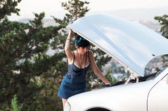 Woman checking the problems with car Royalty Free Stock Photo