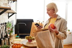 Woman checking products after shopping stock images