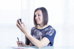 Woman checking a reader Stock Photography