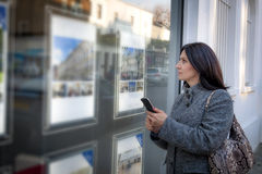 Woman checking the real estate listings Royalty Free Stock Images