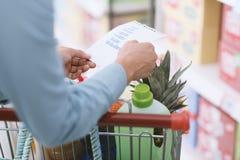 Woman checking a shopping list Stock Photo