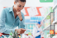 Woman checking a shopping list Stock Photography