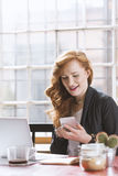 Woman checking social media on the phone Stock Photography