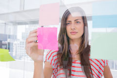 Woman checking sticky note Stock Images