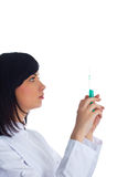 Woman checking syringe. Isolated on the white Royalty Free Stock Photo