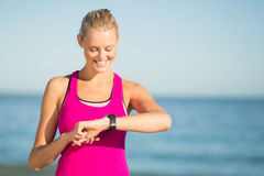 Woman checking time on beach Royalty Free Stock Image